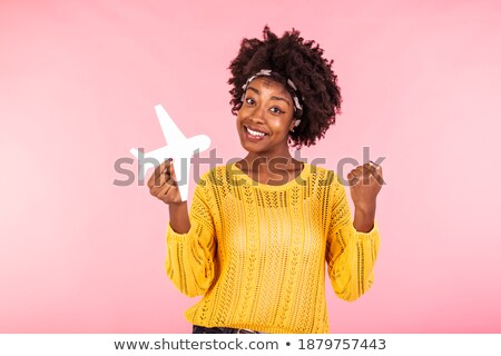 Photo of excited woman 20s with curly hair smiling and holding m Stock photo © deandrobot