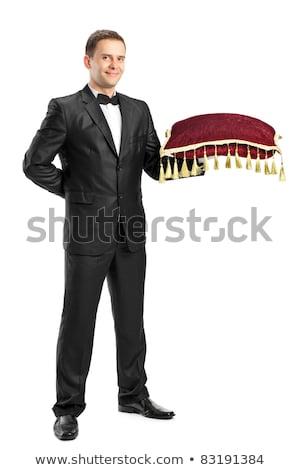 Knap jonge De ober smoking presenteren Stockfoto © deandrobot