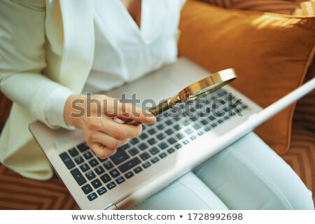 Female detective with magnifying glass Stock photo © colematt