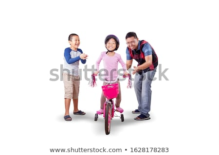 Stock photo: Young girls riding bicycle