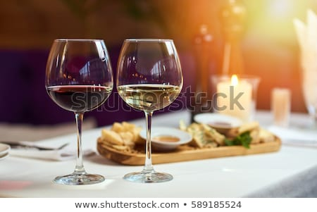 Glasses of white and red wine Stock photo © Alex9500