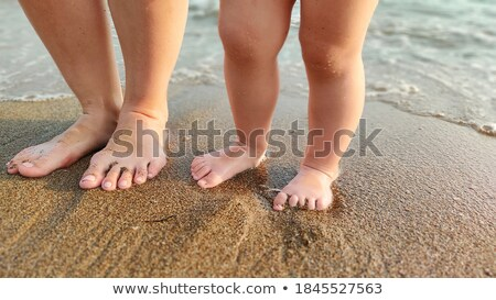 woman child walk seashore sunny day barefoot stock photo © elenabatkova