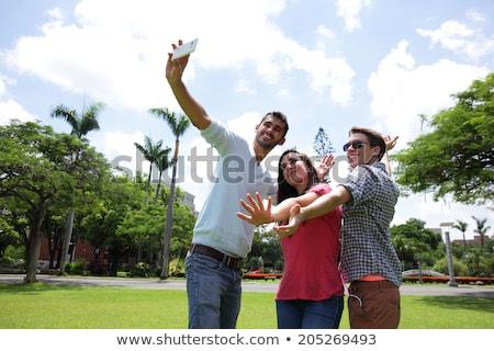 college student taking digital photo smiling stock photo © nyul