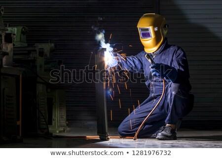 Man using welding machine to weld the metal Stock photo © Kzenon