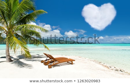 Stock fotó: Beach With Two Sunbeds And Heart Shaped Cloud