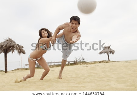 Summer Fun Vacation of Couple Playing Volleyball Stock photo © robuart