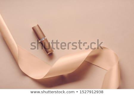 Luxe rouge à lèvres soie ruban beige vacances Photo stock © Anneleven