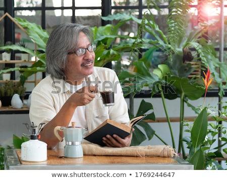 Senior Man In Greenhouse With Hot Drink Stock photo © HighwayStarz