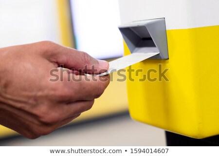 man validating his train or subway ticket Stock photo © nito