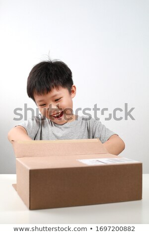 Cute boy carries a gift box. Give gifts and delivery concept Stock photo © galitskaya