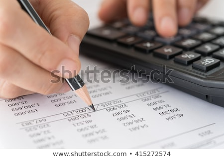 checking the financial statement with the calculator stock photo © johnkwan