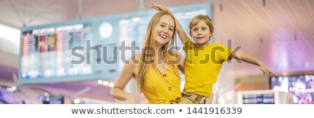 BANNER, LONG FORMAT Family at airport before flight. Mother and son waiting to board at departure ga Stock photo © galitskaya