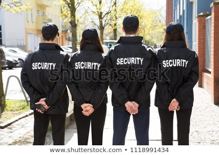 Security Guards Standing In A Row Stock photo © AndreyPopov