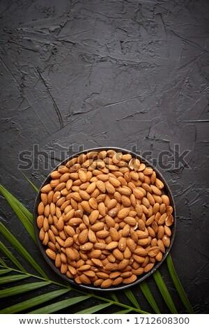 Ensemble amande noix noir plaque pierre Photo stock © dash