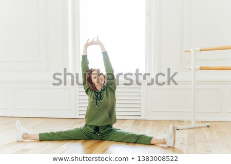 Stock photo: People, strength, fitness, gymnastics concept. Glad sportswoman with cheerful face, raises hands, sp