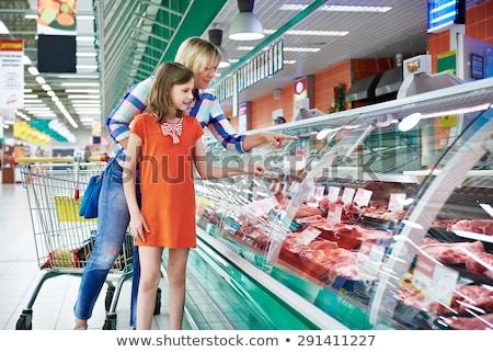 Família compras fresco carne supermercado em pé Foto stock © Kzenon