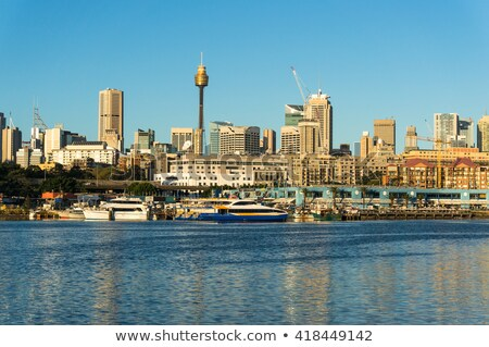 Sydney blauwe hemel wolkenkrabbers exemplaar ruimte business Stockfoto © ShustrikS