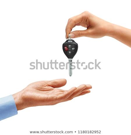 businessman handing a key to a woman hand stock photo © cienpies