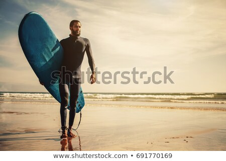 Young surfer, happy young boy at the beach with surfboard Stock photo © galitskaya