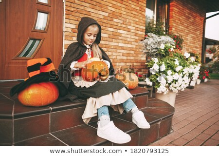 portrait of sitting little girl during Halloween stock photo © phbcz