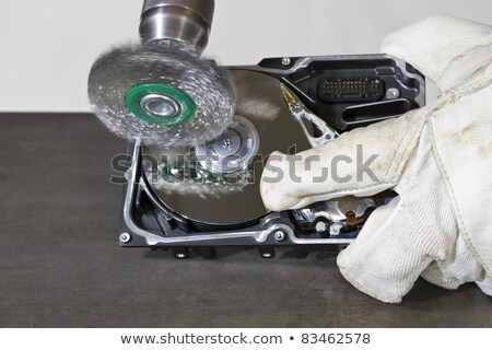 cleaning hard drive with electrical steel brush stock photo © gewoldi