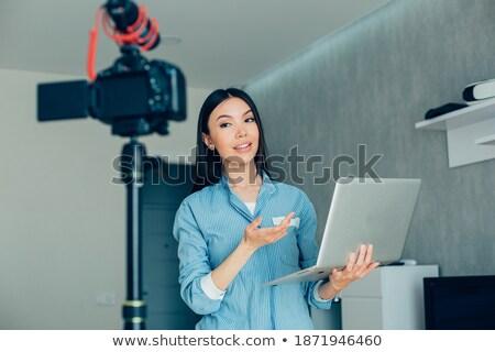 улыбаясь кавказский женщину беспроводных микрофона Сток-фото © Qingwa