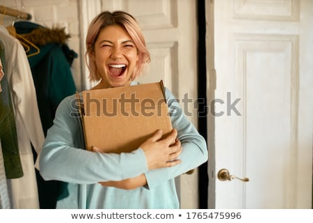 Excited woman going home with her purchases Stock photo © photography33