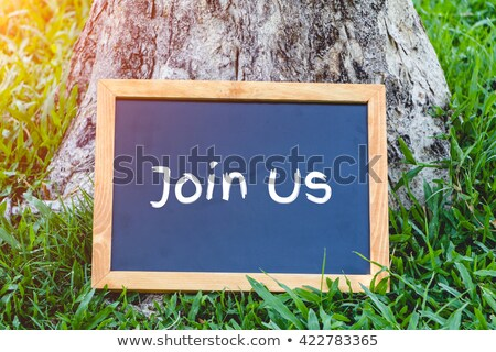 Stock photo: Join us now- text on a blackboard
