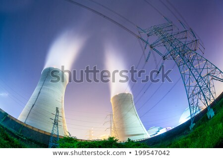 electricity pylon and cooling tower stock photo © devon