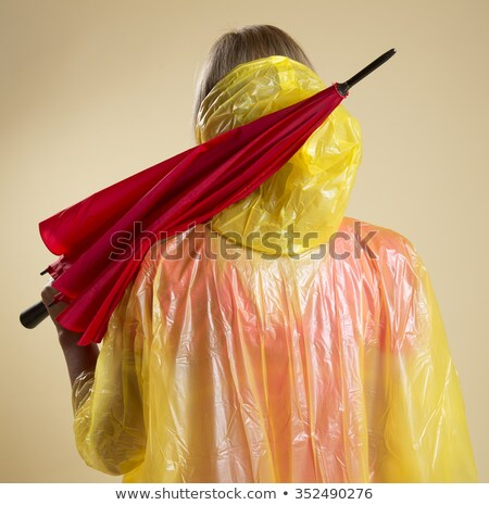 Woman in a red mac with an umbrella Stock photo © photography33