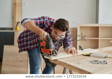 Man with an electric jigsaw Stock photo © photography33