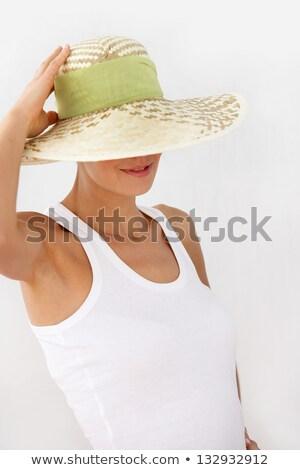 Verlegen vrouw voortvarend hoed gezicht zon Stockfoto © photography33