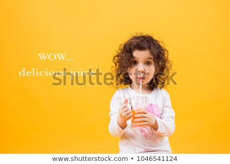Happy smiling girl with fresh fruit juice Stock photo © ilona75