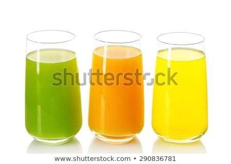 Tropical juices in glasses isolated on white Stock photo © ozaiachin
