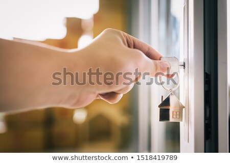 Female estate agent putting key in door Stock photo © photography33