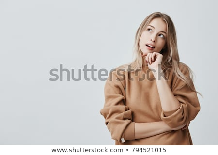 Beautiful girl thinking stock photo © iko