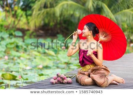 улыбающаяся женщина красное платье счастливым моде Сток-фото © wavebreak_media