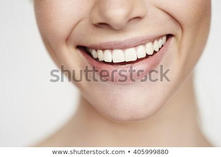 mujer · sonriente · primer · plano · sonriendo · femenino - foto stock © iofoto