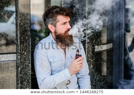 Man smoking ecigarette Stock photo © smithore
