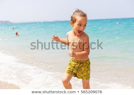 kicsi · fiú · tenger · szőke · egyéves · ül - stock fotó © tanyalomakivska