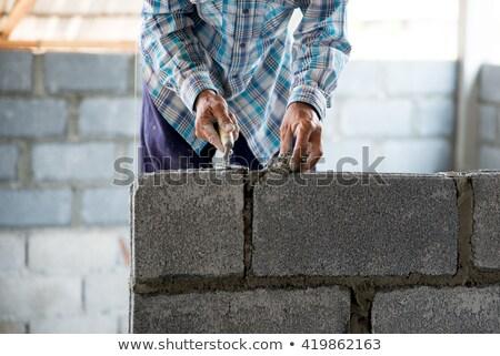 каменщик цемент стены счастливым строительство работу Сток-фото © photography33