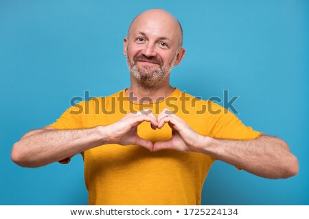 Man making a heart with his hands Stock photo © photography33