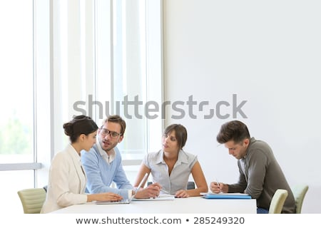 Businesspeople gathered around a table for a meeting Stock photo © Kirill_M