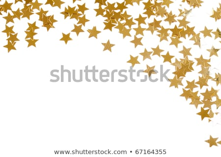 christmas decoration of colored confetti stars against white bac stock photo © oly5