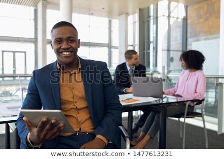 ストックフォト: ビジネスマン · デジタル · タブレット · 現代 · オフィス · 2