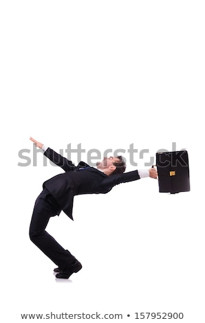 Funny businessman being blown by wind Stock photo © Elnur