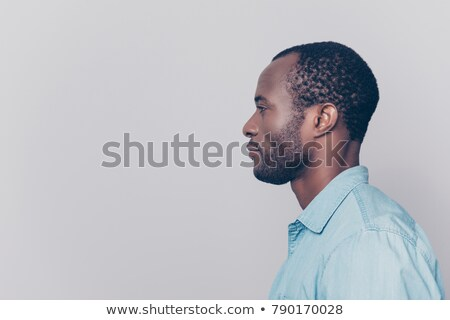 Stock photo: side view of a pensive young casual man