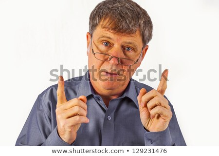 Stock photo: business man is buttonig his shirt