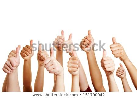 Woman's hand, thumbs up Stock photo © cherezoff