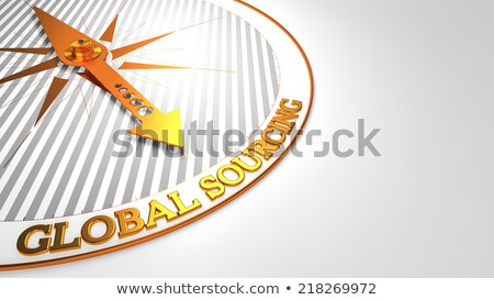 global sourcing on white with golden compass stock photo © tashatuvango